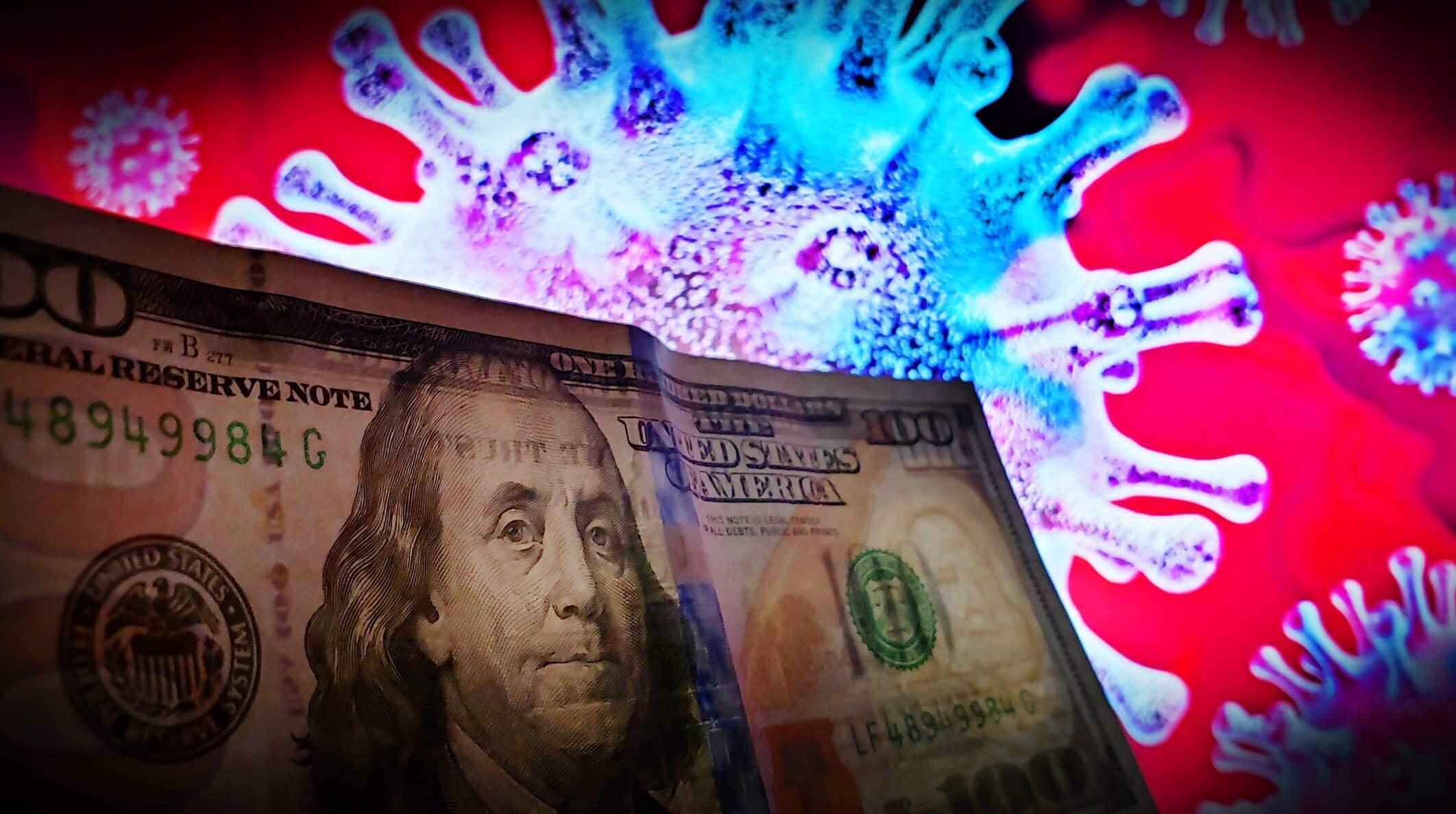 Imagem ilustrativa. Nota de dólar em frente a uma imagem do coronavírus, refletindo o impacto do vírus na economia. (Jorge Araújo\FotosPublicas)